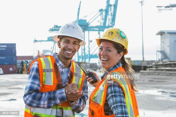 workers at shipping port - dock worker stock photos and pictures