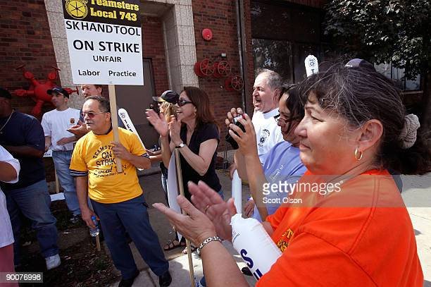 Workers at SK Hand Tools picket outside their plant after their health insurance benefit was cut without notifying them August 25 2009 in Chicago...