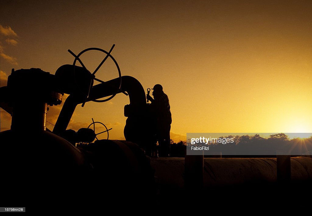 Workers at sunset : Stock Photo