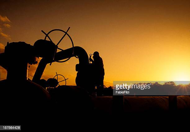workers at sunset - air valve stock photos and pictures
