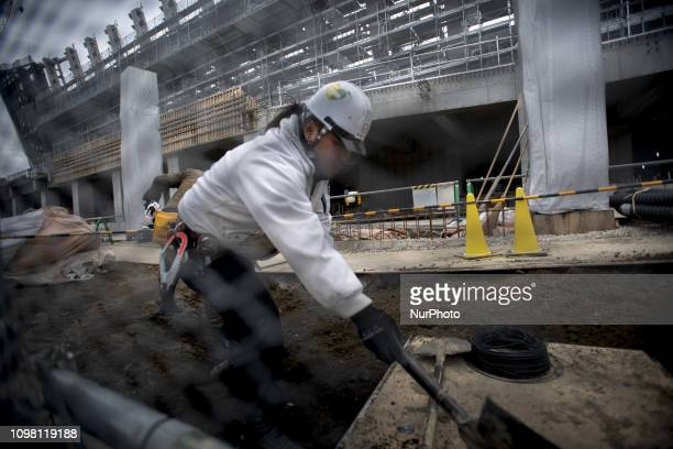 Workers at the Ariake Arena for Volleyball events and Paralympics' wheelchair basketball event venue at the Tokyo 2020 Olympics Tuesday Feb 12 in...