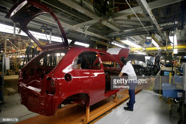 Workers at the assembly line of Corsa vehicles at General Motors factory in the outskirts of Rosario 180 miles North from Buenos Aires Argentina The...