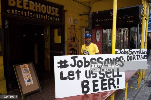 Workers at the Beerhouse, in Long Street join other people working in the restaurant, food and alcohol industry in a nationwide protest against...