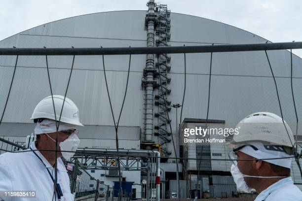 Workers at the Chernobyl Nuclear Power Plant on July 2 2019 in Pripyat Ukraine In November 2016 the 'New Safe Confinement' structure was shifted into...