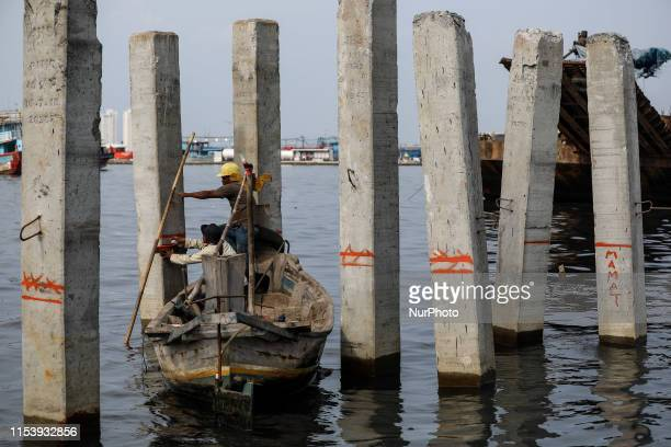 Workers at the construction site of a new bridge at Muara Angke slum area in North Jakarta Indonesia July 5 2019