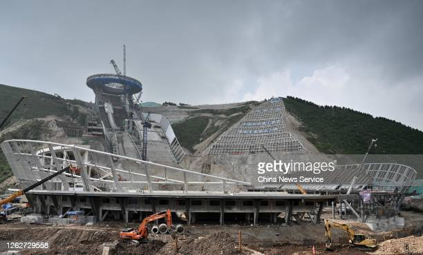 Workers at the construction site of the National Ski Jumping Centre for the Beijing 2022 Winter Olympics on July 30, 2020 in Zhangjiakou, Hebei...