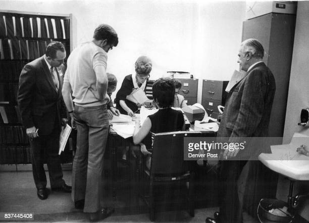 Workers at the Denver Election Commission compile voting results in the City and County Building Crowd milled in halls to see results posted on...