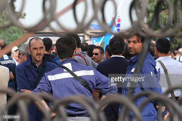 Workers at the Ilva steel mill in Taranto take part in a demonstration against the planned partial closure of the plant on September 27 2012 A local...