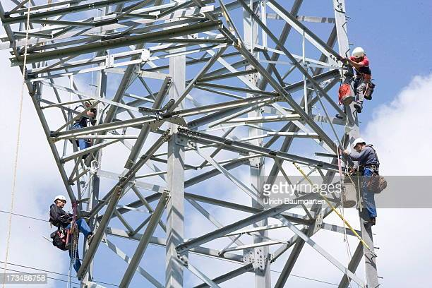 Workers at the installation of an electricity pylon for a 380 kV highvoltage power line on July 10 2013 near Meckenheim Germany