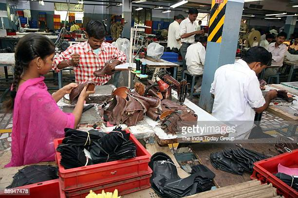 Workers at the Metro & Metro Shoe factory / Footwear unit in Agra, UP, India.