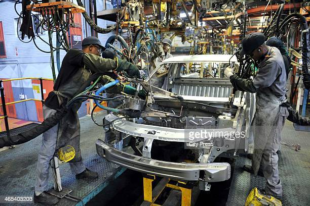 Workers at the Nissan Rosslyn plant on April 17 in Rosslyn South Africa The manufacturer has concluded the first quarter of 2013 with increased sales...