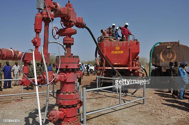 Workers at the Petrodar oil concession flush out the remaining oil prior to a shutdown on oil production by South Sudan on January 29 2012 The new...