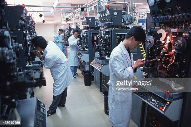 Workers at the Philips passive components factory in Suwon