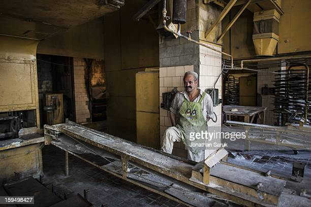 Workers at the Russian built massproduction bakery and grain silo site known as The Silo bake bread July 21 2012 in Kabul Afghanistan The factory...
