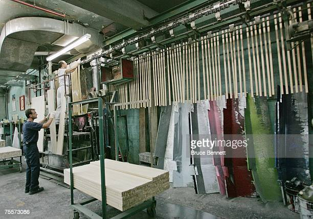 Workers at the SherWood stick factory make wooden hockey sticks on June 28 2007 in Sherbrooke Quebec Canada