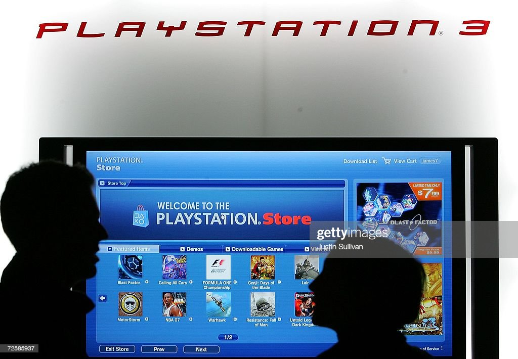 Workers at the Sony Playstation store set up a display