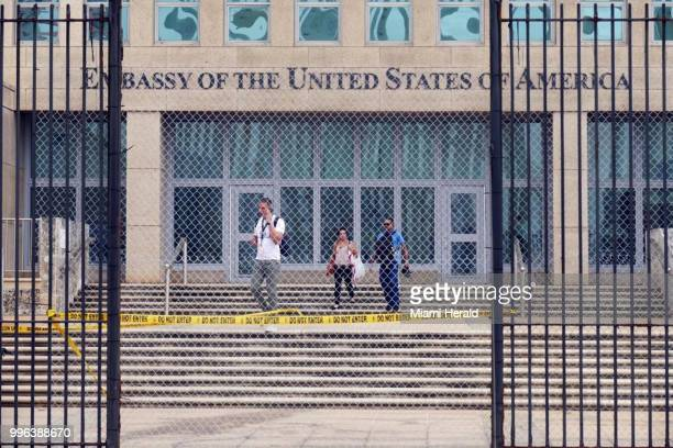 Workers at the US Embassy in Havana leave the building on Sept 29 after the State Department announced that it was withdrawing all but essential...