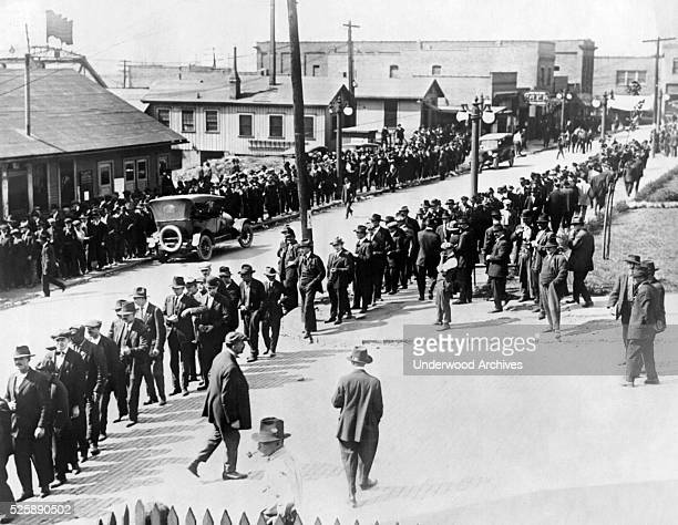 Workers at the Youngstown Sheet and Tube Company line up to draw their last pay before going on strike Youngstown Ohio 1916