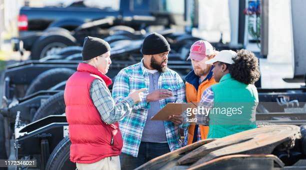 workers at trucking company having meeting - haulage stock pictures, royalty-free photos & images