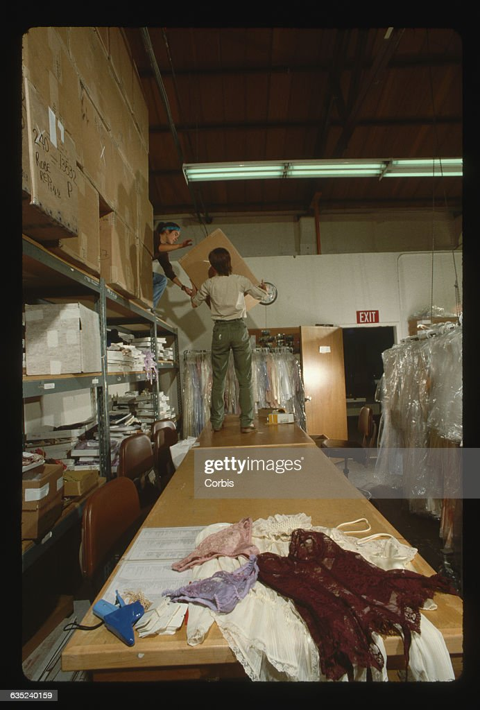 workers at victorias secrets warehouse in san francisco prepare catalog orders duirng the christmas - Christmas Mail Order Catalogs