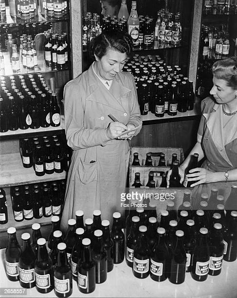 Workers at Wembley Stadium canteen in London check the bottles of beer cider and barley water bought to quench the thirst of the FA Cup Final...