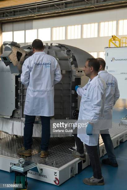 Workers at work on the Airlock commercial space envelope during the press presentation for the International Space Station at Thales Alenia Space...