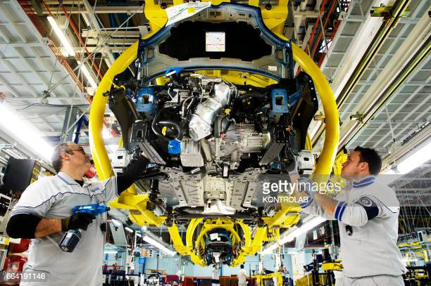 D' ARCO CAMPANIA ITALY Workers at works in FIAT cars factory Giovanbattista Vico in Pomigliano d´Arco near Naples city southern Italy