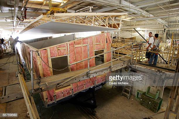 Workers attach a roof to a home at a Fleetwood Enterprises Inc factory on September 23 2005 in Riverside California The Federal Emergency Management...