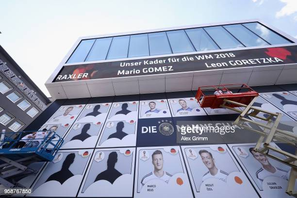 Workers attach the portraits of the nominated players after the presentation of the provisional squad of Germany for the 2018 FIFA World Championship...