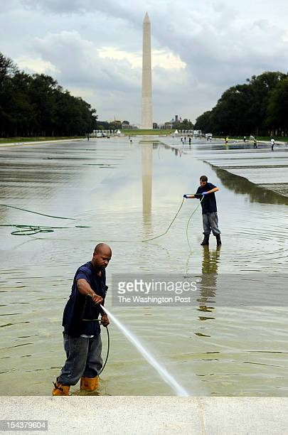 Workers attempt to rid the Lincoln Memorial reflecting pool of algae on Thursday 04 2012 in Washington DC The draining process began Wednesday