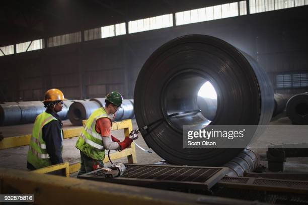 Workers band a steel coil that was set aside for qualitycontrol testing during steel production at the NLMK Indiana steel mill on March 15 2018 in...