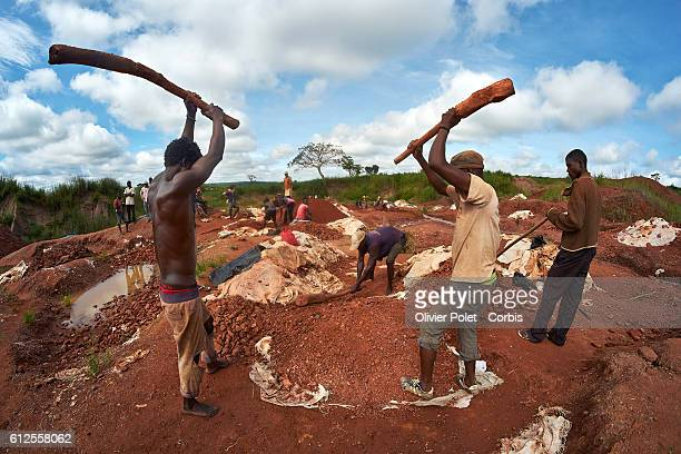 Workers beat the diamondrich rock pieces into a gravel in search of diamonds in their concession 28 March 2013 near an Angolan village not far from...
