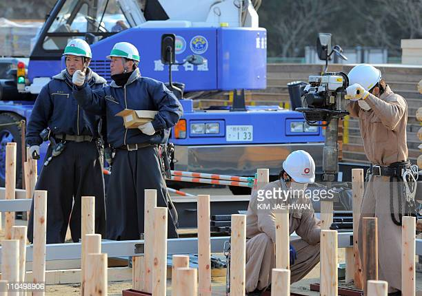 Workers begin construction of temporary housing in the devastated town of Rikuzentakata on March 19 2011 The government of the world's thirdbiggest...