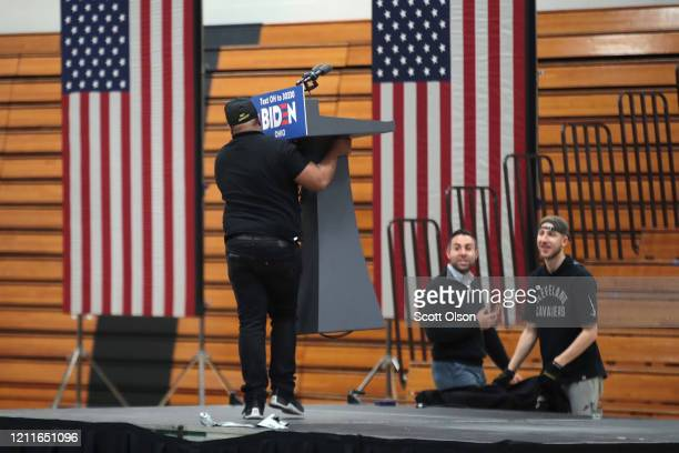 Workers begin to tear down the setup at Cuyahoga Community College where Democratic presidential candidate former Vice President Joe Biden was...