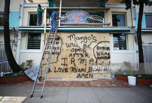 Workers board up the Mango's Restaurant and Night Club as the city prepares for the approaching Hurricane Irma on September 7 2017 in Miami Beach...