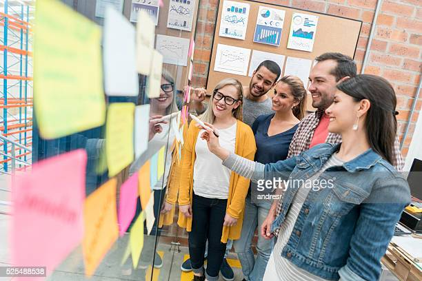 Workers brainstorming at a creative office