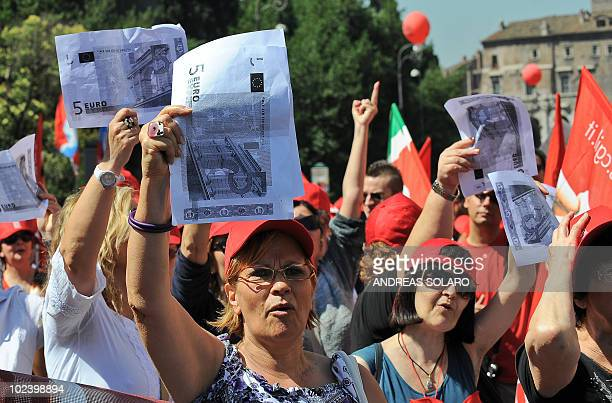 Workers brandish a copy of 5 euro banknotes as they march during a demonstration organised by the leftwing General Confederation of Italian Workers...