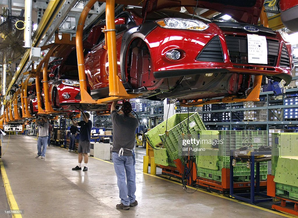Workers Build A Ford Focus On The Assembly Line At Motor Co