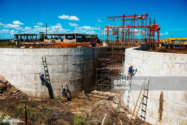 Workers build a hydro pumping station which will supply water from the Limpopo river to nearby rice farms owned by Wanbao Grains Oils Co a Chinese...