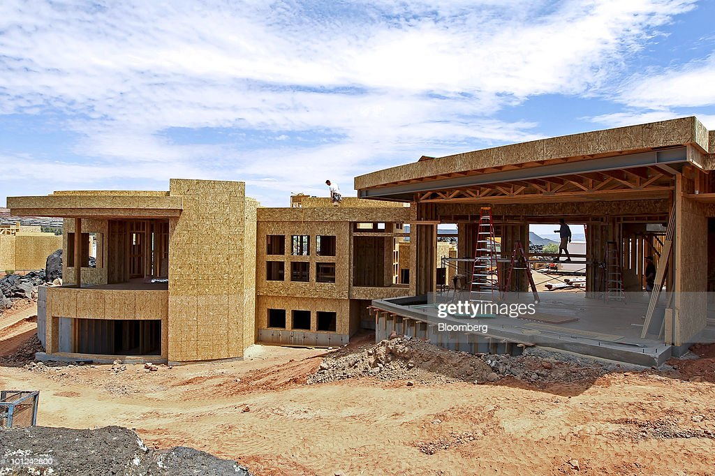 Workers build a new home under construction at the Split Rock at Entrada development in St. George, Utah, U.S., on Wednesday, May 26, 2010. Housing starts rose to a 672,000 annual rate last month, the highest since October 2008 and up 5.8 percent from March, Commerce Department figures showed this month. After almost five years of falling sales and prices, homebuilders are looking to see if the nation's fledgling economic recovery can sustain the real estate market as government subsidies end. Photographer: George Frey/Bloomberg via Getty Images