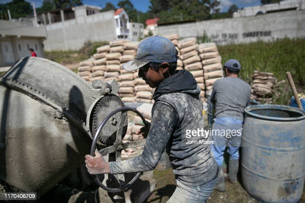 Workers build a new remittance house on August 26 2019 in Salcaja Guatemala The foreman said the owners are Guatemalan immigrants living in New York...