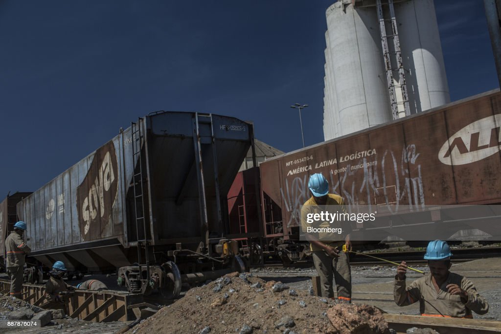Workers build a retaining wall next to railroad tracks at the Port of Santos in Santos, Brazil, on Thursday, Oct. 5, 2017. The port complex is a 3-square-mile microcosm of a country buffeted by political turmoil, drug-fueled violence and persistent income inequality as it emerges from a grinding recession. Photographer: Dado Galdieri/Bloomberg via Getty Images