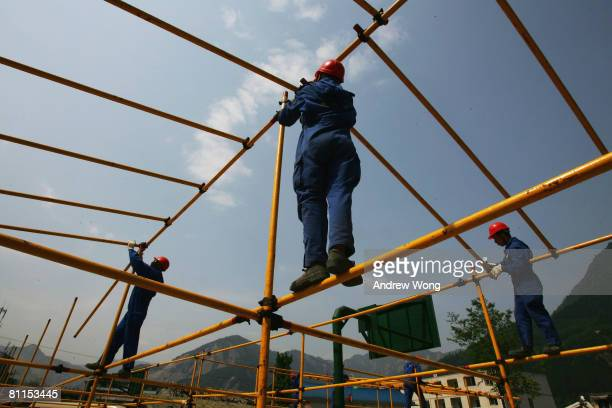 Workers build a temporary accommodation for survivors on May 19, 2008 in Shifang, Sichuan province, China. A major earthquake measuring 7.9 on the...