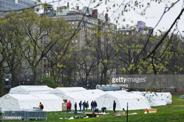 Workers build an emergency field hospital across the street from Mount Sinai in Central Park in New York US on Monday March 30 2020 New York State...