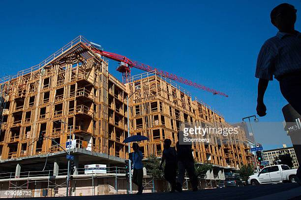 Workers build apartments at a construction site in the Little Tokyo neighborhood of downtown Los Angeles California US on Tuesday June 30 2015 The US...