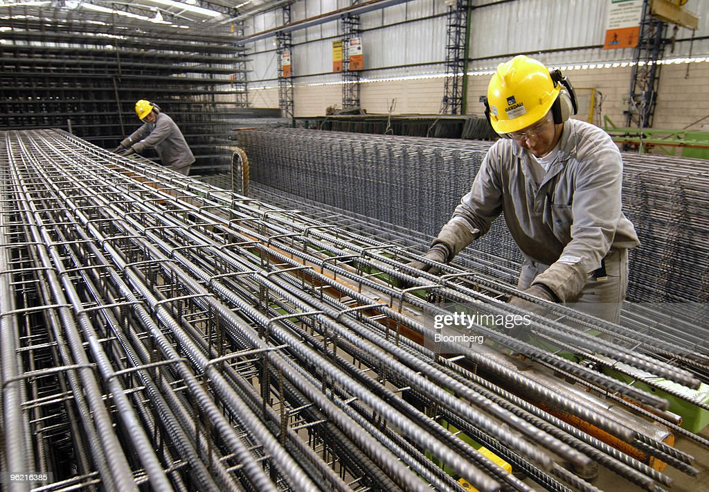 workers build columns of rebar to be used in construction at a gerdau sa steel plant