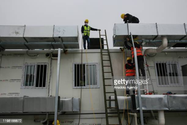 Workers build hospital on February 3 2020 in Wuhan China After only 10 days of construction Wuhan Huoshenshan Hospital was officially completed and...