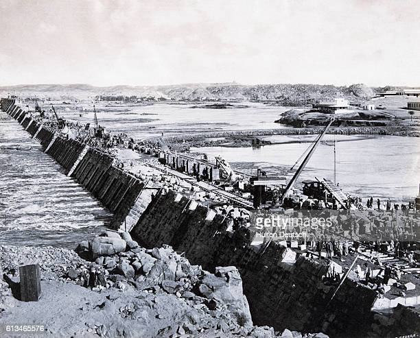 Workers build the Aswan Dam across the Nile River in Egypt in the 1890s and early 1900s