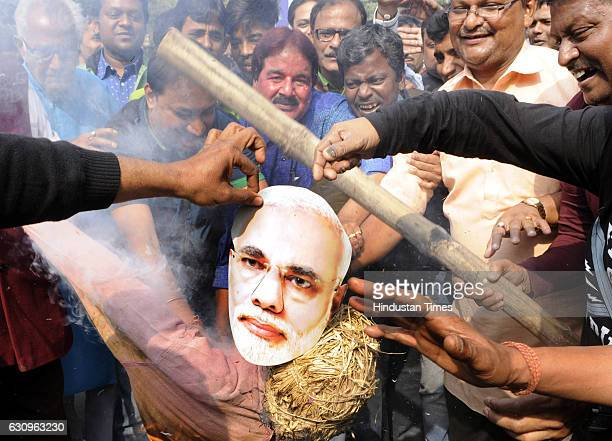 TMC workers burn effigy of Prime Minister Narendra Modi during a protest against the arrest of Trinamool Congress MP Sudip Bandyopadhyay by CBI on...