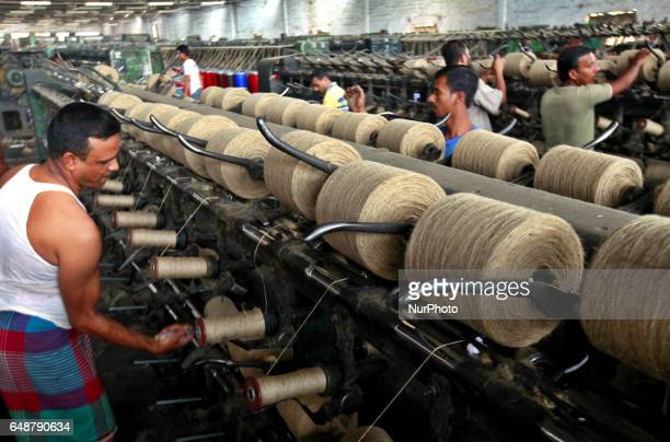 Workers busy with processing raw jute fibre and manufacturing jute products at Karim Jute Mill in Demra Dhaka on March 5 2017